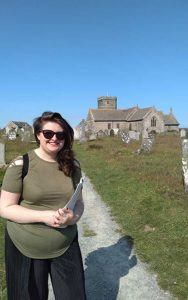 Shannon stands in front of Tintagel church